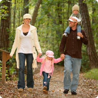 family-walking-woods