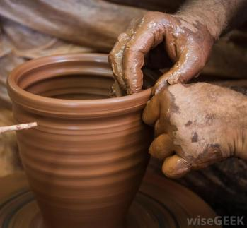 persons-hands-with-pottery