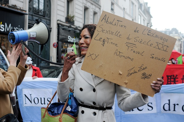 Sex workers protest against a law which aims at criminalizing the customer of a prostitute in Paris, France, on March 28 2015. The law is to arrive in the French Senate on the 30th and 31st of March, after it was passed on the lower Assembly in december 2013. Photo by Alain Apaydin/ABACAPRESS.COM