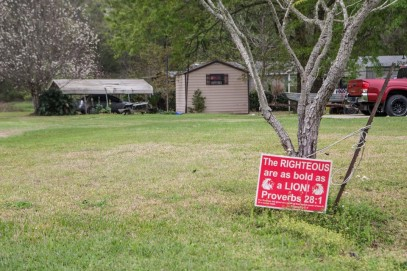 A yard sign with a bible scripture is posted in a yard in Kountze, TX Friday March 18, 2016.